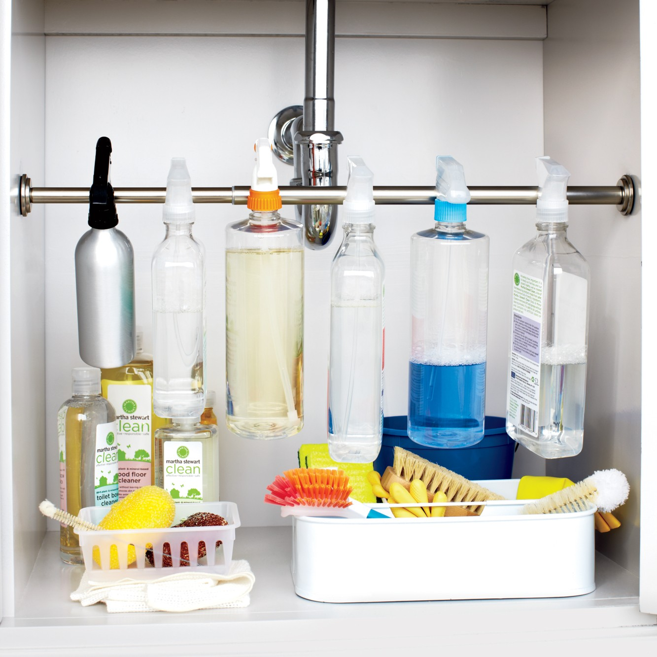 Use the Tension Rod under Your Sink to Store Cleaners