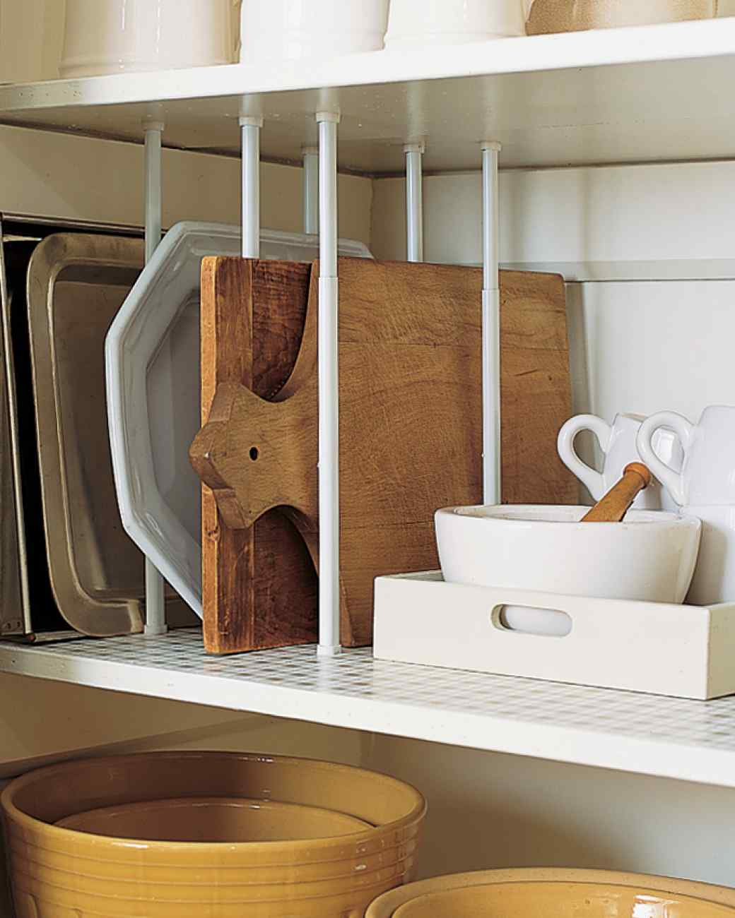 Use Curtain Rods as Shelf Dividers