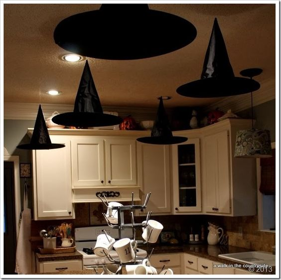 Good Halloween Kitchen Decorating Ideas #7 - ... Everyone That You Brew Magic In The Kitchen Daily. Simply Use Tacks And  Clear Fishing Line To Create The Illusion That The Hats Are Floating In  Mid-air.