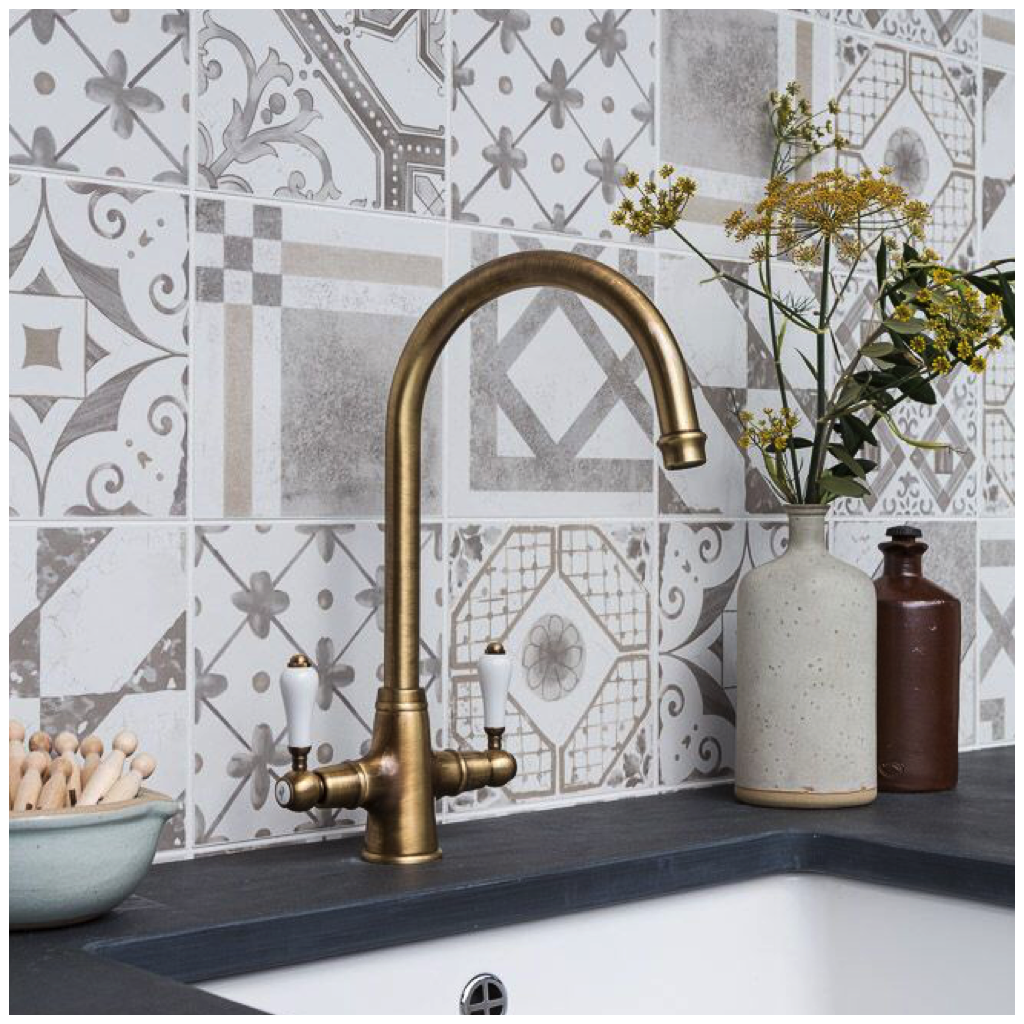 This backsplash uses matte patterned tiles in an elegant combination of blue tinted white and gray using tiles with mismatched patterns easily gives you a